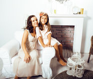 Happy smiling mother with little cute daughter at home interior, lifestyle people concept Stock Images