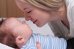 Happy smiling Mother and 3 month old baby boy Royalty Free Stock Image
