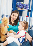 Happy smiling mother with one year old baby Stock Photography