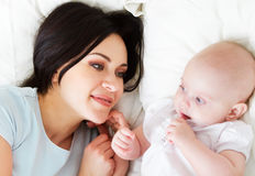 Happy smiling mother with six month old baby girl Stock Image