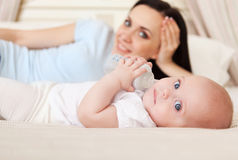 Happy smiling mother with six month old baby girl Stock Images