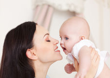 Happy smiling mother with six month old baby girl Royalty Free Stock Images