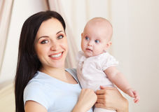 Happy smiling mother with six month old baby girl Royalty Free Stock Photos