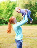 Happy smiling mother with son child having fun outdoors Royalty Free Stock Image