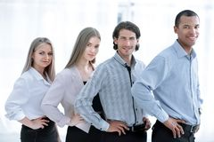 Happy smiling multi ethnic business team in office stock images