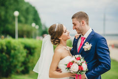 Happy smiling newlyweds having fun and kissing Stock Photo