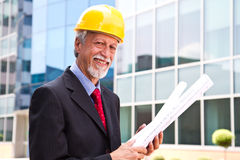 Happy, smiling older architect looking out Stock Photos