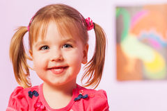 Happy and smiling portrait of girl with ponytails Stock Photos