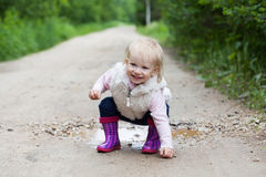 Happy smiling portrait of a 2 year old blonde girl Stock Photo