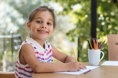 Happy Smiling Preschool Child Girl Drawing Pictures Royalty Free Stock Photo