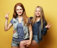 Happy smiling pretty teenage girls or friends. People, teens and friendship concept - happy smiling pretty teenage girls or friends hugging and showing peace Stock Photos