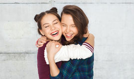 Happy smiling pretty teenage girls hugging Royalty Free Stock Photography