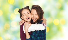 Happy smiling pretty teenage girls hugging Stock Photography
