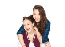 Happy smiling pretty teenage girls hugging Royalty Free Stock Images