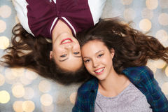 Happy smiling pretty teenage girls lying on floor Royalty Free Stock Photography