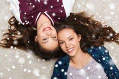 Happy smiling pretty teenage girls lying on floor Stock Images