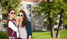 Happy smiling pretty teenage girls in sunglasses Royalty Free Stock Photo