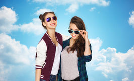 Happy smiling pretty teenage girls in sunglasses Stock Photo