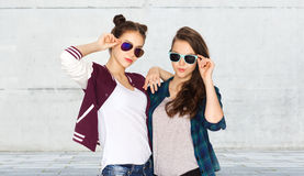 Happy smiling pretty teenage girls in sunglasses Stock Photos
