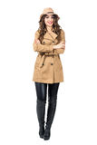 Happy smiling pretty woman wearing hat and coat with crossed arms looking at camera Royalty Free Stock Photo