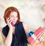 Happy smiling red-haired woman with boxes gifts Stock Images