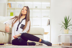 Happy smiling relaxing young woman Royalty Free Stock Image