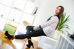 Happy smiling relaxing young woman Stock Images