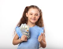 Happy smiling rich kid girl holding money and showing thumb up s stock images