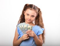 Happy smiling rich kid girl holding money two hands on white bac. Kground with empty copy space Stock Image