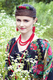 Happy smiling Russian woman sitting in the field Stock Images