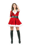 Happy smiling Santa Claus female showing thumbs up hand sign. Stock Images