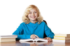 Happy smiling school girl reading books Stock Photo