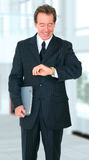 Happy Smiling Senior Businessman Checking Time Stock Image