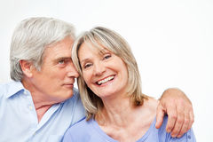 Happy smiling senior couple. Embracing at home Royalty Free Stock Photo