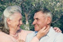 Happy and smiling senior couple. Elderly couple. Portrait happy and smiling senior couple in love closeup. Elderly couple walking Stock Image