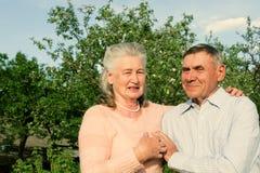 Happy and smiling senior couple. Elderly couple. Portrait happy and smiling senior couple in love closeup. Elderly couple walking Stock Photos
