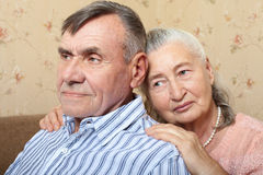 Happy smiling senior couple embracing together at home Stock Photo