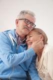 Happy smiling senior couple. Enjoys hugs in your home Stock Photos
