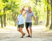 Portrait of a beautiful happy senior couple in love dancing in the park. Happy smiling senior couple in love, dancing and having fun in the park. Being together Stock Photos