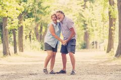 Portrait of a beautiful happy senior couple in love dancing in the park. Happy smiling senior couple in love, dancing and having fun in the park. Being together Royalty Free Stock Photos