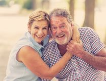 Portrait of a beautiful happy senior couple in love dancing in the park royalty free stock images