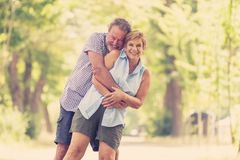 Portrait of a beautiful happy senior couple in love dancing in the park. Happy smiling senior couple in love, dancing and having fun in the park. Being together Royalty Free Stock Image