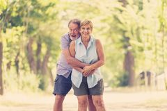 Portrait of a beautiful happy senior couple in love relaxing in the park. Happy smiling senior couple in love, relaxing, dancing and having fun in the park Royalty Free Stock Image