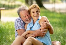 Portrait of a beautiful happy senior couple in love relaxing in the park Royalty Free Stock Image