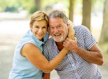 Portrait of a beautiful happy senior couple in love relaxing in the park Royalty Free Stock Photography