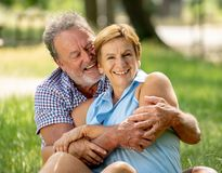 Portrait of a beautiful happy senior couple in love relaxing in the park Stock Images