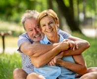 Portrait of a beautiful happy senior couple in love relaxing in the park Royalty Free Stock Photo