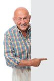 Happy smiling senior man holds a blank board Stock Image