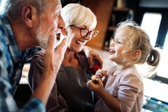 Free Happy Smiling Senior Randparents Playing With Their Granddaughter Stock Photo - 186528870