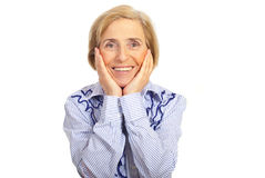 Happy smiling senior woman. Holding face in hands isolated on white background Stock Images